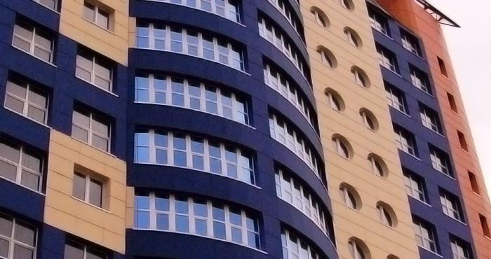 Отделка здания панелями латонит